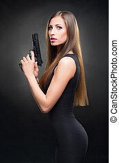 girl in a black dress holding a gun - sexy girl in a black...