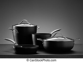 cookware - close up view of nice cookware set on grey color...