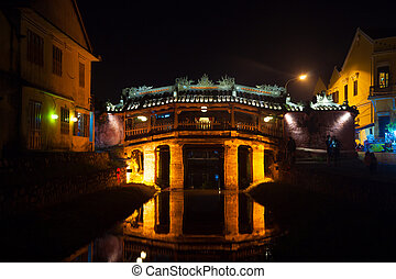 Old japanese bridge at night in Hoi An