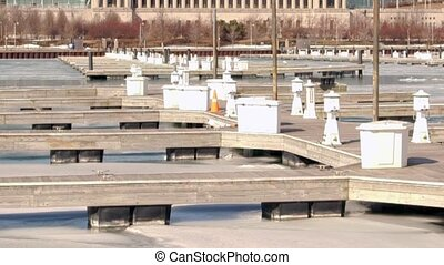 Ice covered boat harbor Chicago, IL - Boat harbor on Lake...