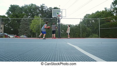 Young boys playing basketball 4K - Young boys playing...