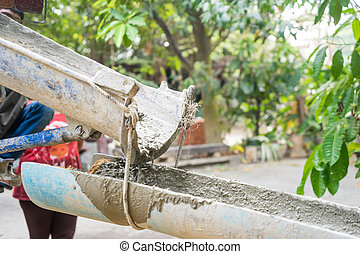 Cement truck - Concrete being poured from a truck