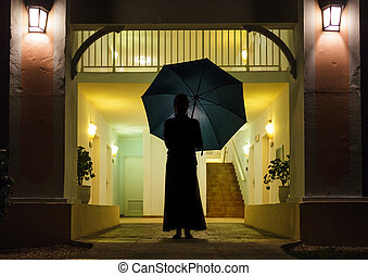 Woman in Silhouette Holding Umbrella