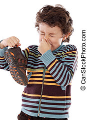 Boy with stinky - Cute young boy with stinky shoe pitching...