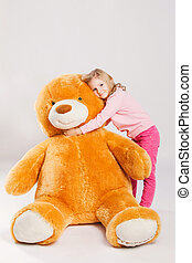 little girl with big teddy bear studio shot - Little girl...