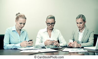 Mobile Apps for Business - Front view of three ladies at the...