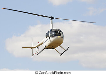 Light helicopter in flight