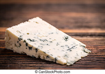 Blue cheese - Piece of gorgonzola cheese on wooden board