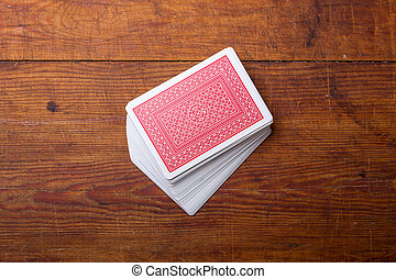 palying cards on wooden table - deck of cards on wooden...