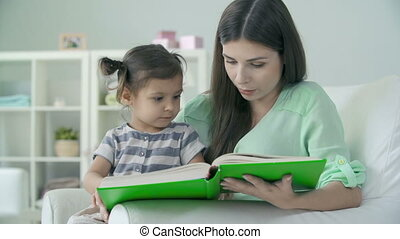 Juvenile Literature - Close up of mother and daughter...