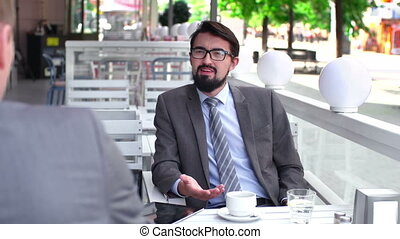 Business Networking - Close up of businessman chatting with...