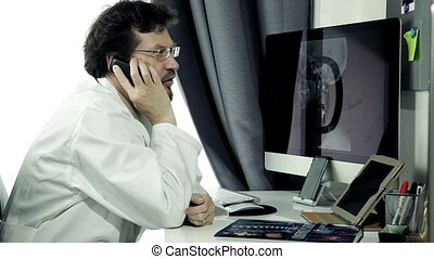 Doctor on the phone in office