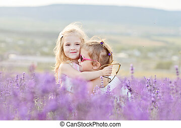 two happy girls in field