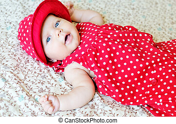 sweet baby wearing dotted dress and hat