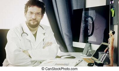 doctor sitting at desk smiling