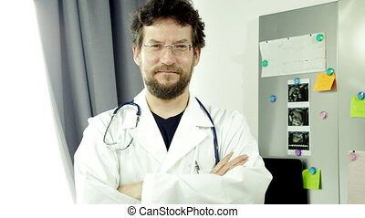 doctor looking camera thumb up - Cool doctor smiling looking...