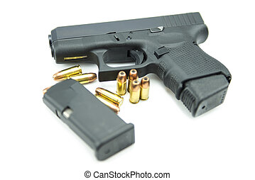 Black gun and 9mm bullets isolated a white background