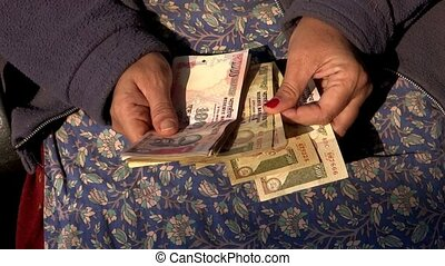 Money Counting - A woman counting Indian money