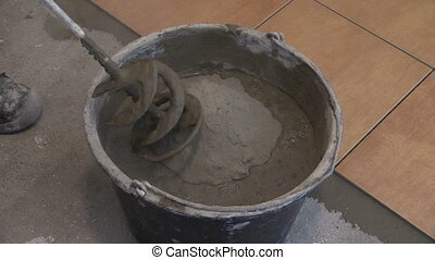 mixing tile glue - Mixing tile adhesive or cement with power...