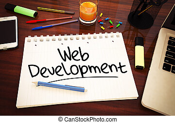 Web Development - handwritten text in a notebook on a desk -...