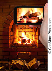 tourist photographs of burning wood in fireplace - travel...