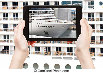 tourist photographs of big cruise liner - travel concept -...