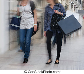 Women Shopping - Women walking and shopping with motion blur