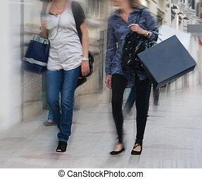 Women Shopping - Women walking and shopping with motion blur