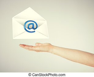 hand holding envelope with email sign - picture of hand...