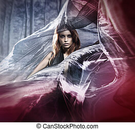 Young attractive woman in blowing silk - Halloween photo of...