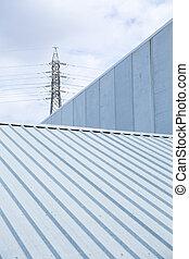 Four ventilation pipes over blue sky closeup