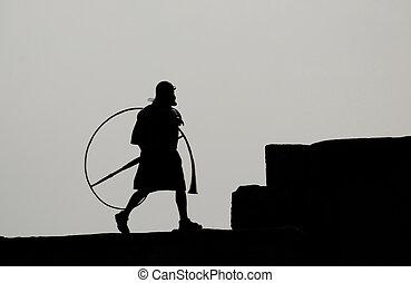 men dress as Roman soldier
