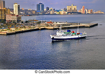 Ship arriving to havana bay - A view of havana city skyline...
