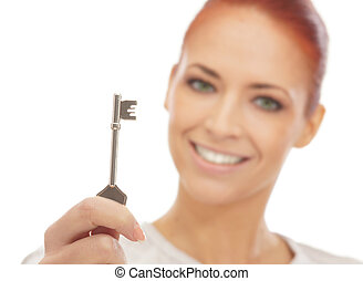Young attractive woman with the key face is not in focus