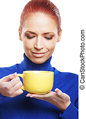 Young woman with the cup of tea