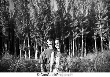 Happy young couple in love outdoor in summer
