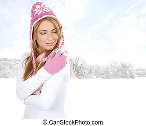 Young attractive woman wearing winter dress