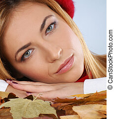 Portrait of young and beautiful woman in autumn style