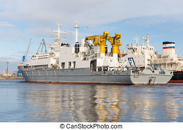 Rescue ship - a rescue ship is moving in the port