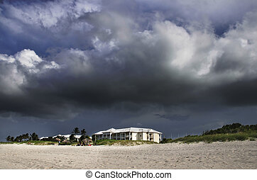 Tropical storm - A view of seaside building under tropical...