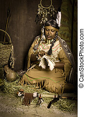 Storyteller squaw - Weathered mature tribal female...