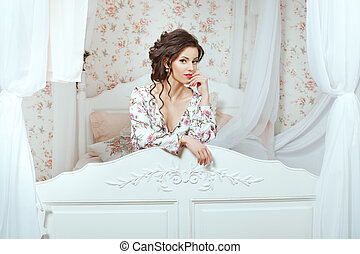 Girl peeking through the headboard - Delicate brunette girl...