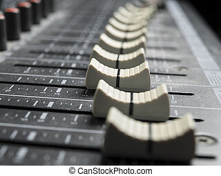 Faders on the mixing desk - Mixing board faders , for music...