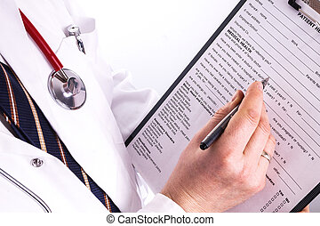 Male doctor ready to write patient information - Male doctor...