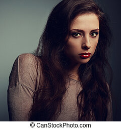 Sexy female makeup model looking dramatic with red lipstick....