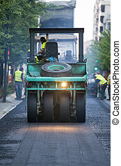 Heavy Vibration roller compactor at asphalt pavement works...