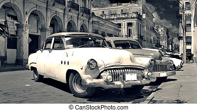 Old Havana cars panorama b and w - Panoramic view of shabby...