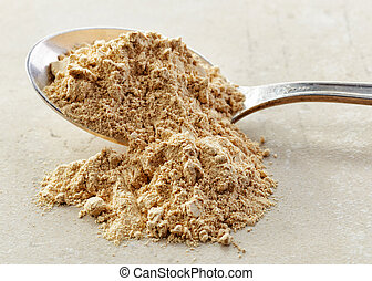 spoon of maca powder - spoon of healthy maca powder