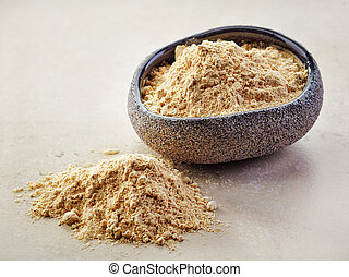 bowl of maca powder - bowl of healthy maca powder