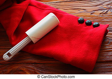 Lint Rollers - on a wooden board roller for cleaning coats